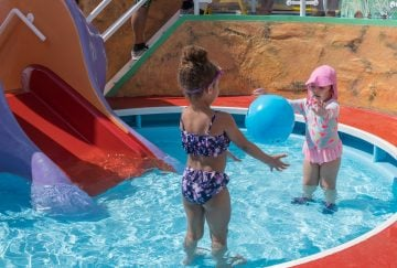 two adorable kids having so much fun in their pool activity at puzzle house
